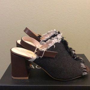 Black distressed brown sandal heel.